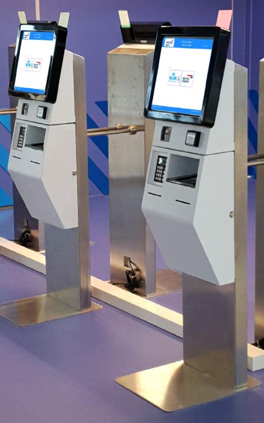 Photo of self-service passenger processing kiosks